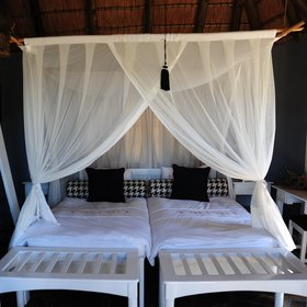 …or twin beds, a dressing table, air conditioning, mosquito nets, and a safe…