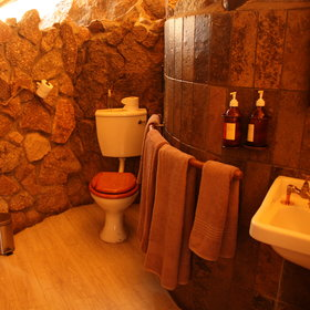 At the back of the chalet is an en-suite bathroom with flush toilet...
