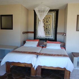 Each room has a double bed with a mosquito net…