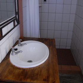 The en-suite bathroom is spacious and clean,…