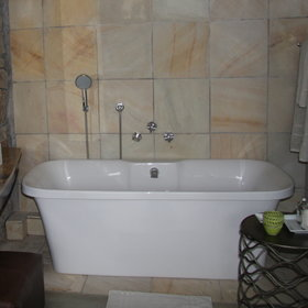 …and a beautiful free standing bath,…