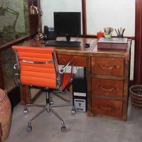 …a writing desk and computer with internet access in one corner.