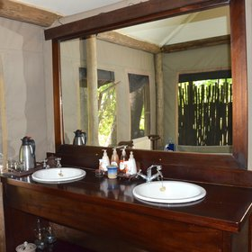 The en-suite bathrooms include a twin-basin washstand,…