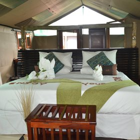 The rooms feel light and airy; each has double or twin beds...