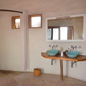 The en-suite bathrooms have large walk-in showers and twin basins...