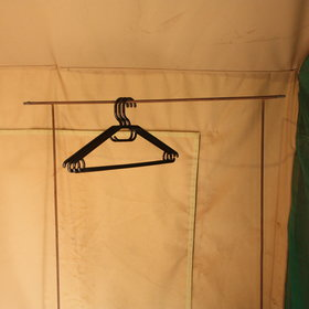 and a rail for hanging clothes.