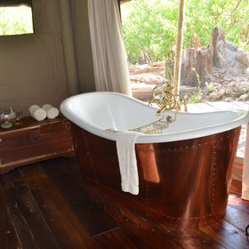 ...a luxuriously deep copper bath.