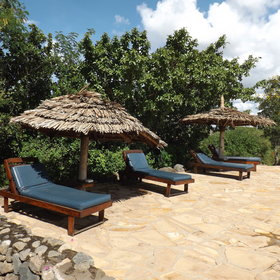 …surrounded by sun loungers – the perfect place to relax whilst waiting for a flight!