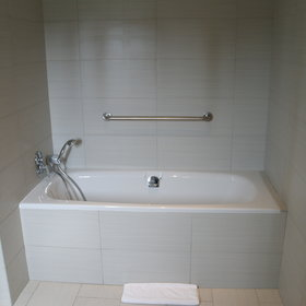 …and a shower, the wheelchair access room also includes a bath tub.
