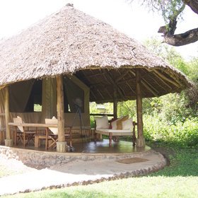 The stylish tents have thatched roofs…