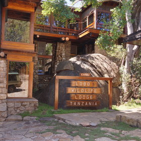 Lobo Wildlife Lodge has a old-fashioned, stone structure…