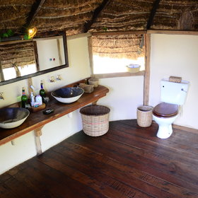 The en-suite bathrooms have basins, a shower and flush loo…