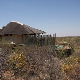 The main area and the nine chalets of the camp face an active waterhole.