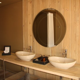 The en-suite bathroom has twin basins ...
