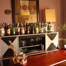 There is a small bar where guest can relax and enjoy a drink.