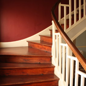 A wooden staircase leads to the upstairs rooms...