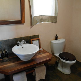 At the back of the kulala is an en-suite bathroom with flush toilet, single basin...