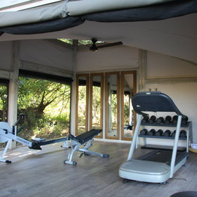 There is also a small gym behind the pool.