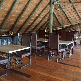 Mivumo River Lodge has a central dining area...