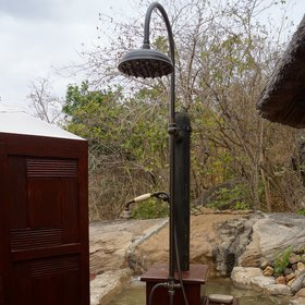 ...as well as an good outdoor shower with views down the river.