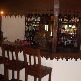 The central area has a bar with friendly staff ready to serve you a refreshing drink.