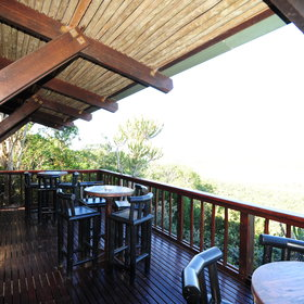 You can dine open-air here, with views over the surrounding bush,…
