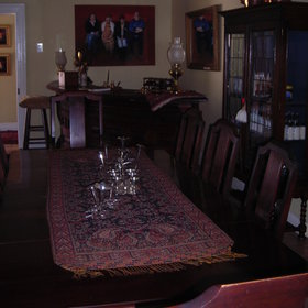 Other rooms include a dining room with kitchen and a large dining table.