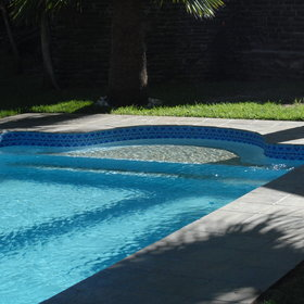 The garden is also home to a sparkling pool...