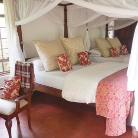 ...and furnished with a wooden four-poster bed (or twin or triple beds),...