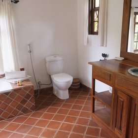 The en-suite bathrooms have a single washbasin, toilet...