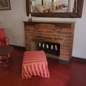 In the two-room cottages you'll find a small seating area beside the fireplace...