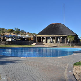 The lodge offers a swimming pool with a pool bar next to it...