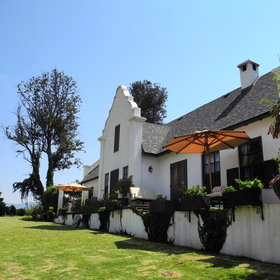 It is tastefully built in the Cape-Dutch style.