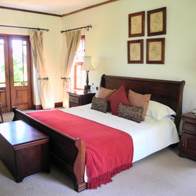 Each cottage has a double bedroom with a large king-size bed ...