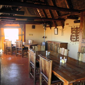 In the main area there is a small dining room with hand-made furniture...