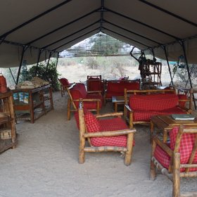 There is a main tent with comfortable seating areas to relax after a long day.