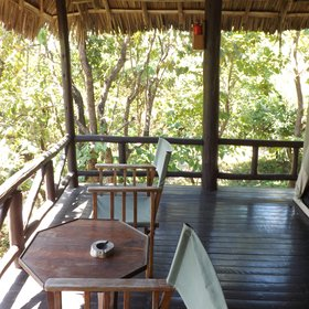 Each safari tent, under its thatched roof, has a private veranda...