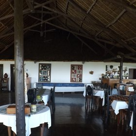 Meals are taken in the high-ceilinged thatched main building...