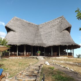 ...where the main area is this striking thatched structure on the top of the kopje...