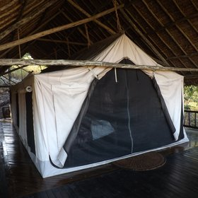 ...where you'll find your tented bedroom suspended beneath a beautiful thatched roof.