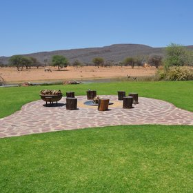 The beautiful outdoor area has a fire bowl around which to enjoy a sundowner...