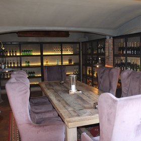 ... and a well-stocked wine store that doubles as a TV screening room and private dining area.