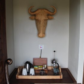 You enter the room from the back, into a small area with tea and coffee making facilities.