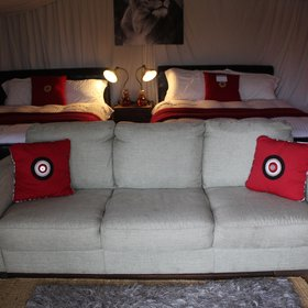 Sofas at the foot of the beds...