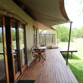From the room, accessed through sliding glass doors, is the veranda...