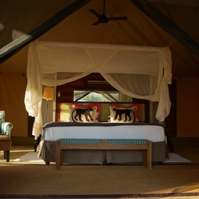 …with a large double bed under a mosquito net…