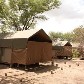 The tents at Nambwa Lagoon Camp are positioned on the edge of the lagoon.