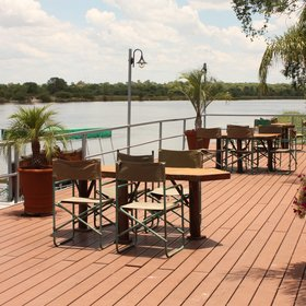 ...or outdoors on the spacious deck overlooking the river.