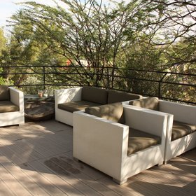 The patio also has comfortable seating where you can enjoy a drink while watching the sunset.
