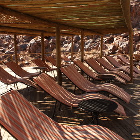 ...with many sun-loungers under a shade to one side.